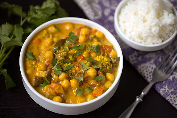 A fresh and uncomplicated approach to a balanced vegetarian curry with garbanzo beans, crisp-tender vegetables and a creamy coconut milk sauce.