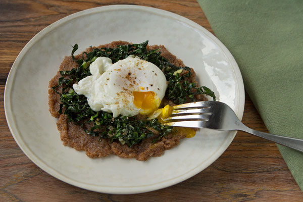 Truffle, Parmesan & Black Garlic Teff Polenta with Kale and Poached Eggs