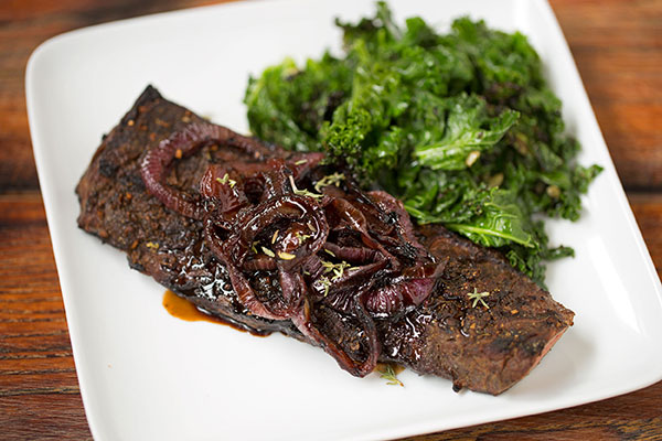 Porcini Rubbed Skirt Steak with Balsamic Onions