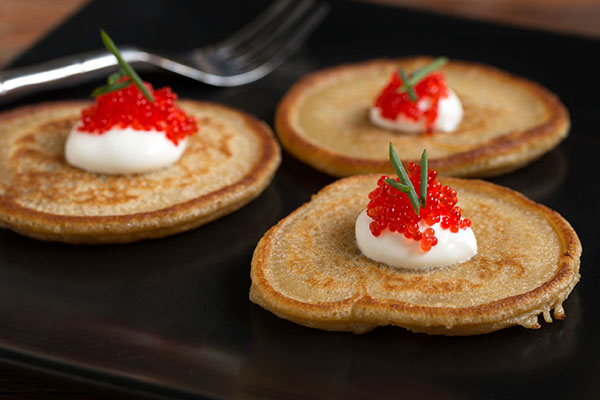 Oyster Mushroom Powder Blini with Creme Fraiche and Salmon Roe